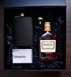 Simple and to the point, a silver tie bar and a bottle of Hennessey for our Tin Man groomsmen. Groomsmen Boxes, Silver Tie, Tin Man, Whiskey Bottle, Bar, Simple, Wedding, Mariage, Weddings