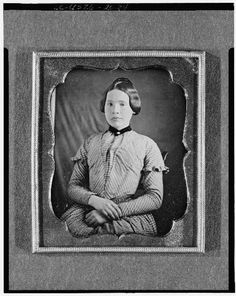 Unidentified Photographer Daguerreotype, 1850-1860--Unidentified woman, half-length portrait, facing front, LOC--young teenager with nice braided bun, cute sleeves