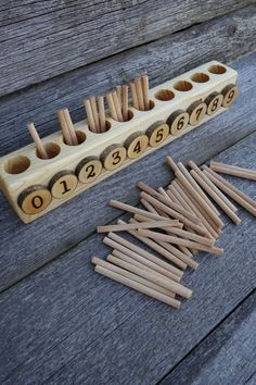 This is an alternative version of the original Monetssori Spindle Box. It is small and perfect for home use where every inch of space counts. It Kleinkinder und Vorschulkinder Spindle box, Montessori math, Educational wooden toy Montessori Toddler, Montessori Activities, Toddler Activities, Preschool Activities, Toddler Toys, Montessori Kindergarten, Dinosaur Activities, Montessori Education, Wood Toys