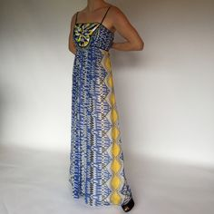 Anthropologie Tribal Chiffon Maxi Dress This dress is super cute & fun! So much detailing in true Anthropologie form! By Ranna Gill, this chiffon maxi in blue, black, green & yellow has lots of pleating details & makes the perfect 'swoosh' when walking. The whole bodice has pintuck pleats & the front is embroidered & beaded with a bead tassel edging. Fully lined. Worn only once while I was 6 months pregnant. Perfect with a baby bump or not! Anthropologie Dresses