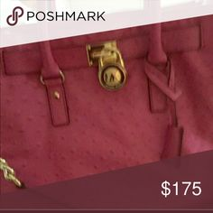 Michael kors large size pink hamilton euc This is excellent condition is the ostrich leather large size hamilton beautiful bag bought it on posh but the hamilton is to stiff for me and I have enough pink bags Michael Kors Bags Shoulder Bags