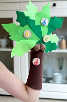 Learn how to make an adorable Chicka Chicka Boom Boom tree puppet to accompany the classic book with no sewing required! Great for early literacy, letter recognition, and pretend play.