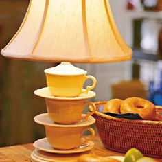 Homemade teacup lamp.  Cute idea for making a lamp base with things have around your house.