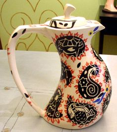 slip cast teapot paisley design with scraffito, tall and curvy.  For sale at:  http://www.etsy.com/shop/georgiesmom
