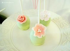 cakepops for this light green and pink girl baptism party