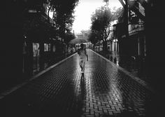 Rain. - #mobilephoto #blancoynegro #byLUMIA #blackandwhite #bnw #buenosaires #barriochino #rain #umbrella #igers #streetphotography