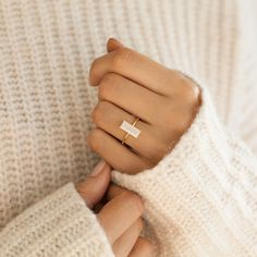 Delicate and simple gemstone gold ring. The baguette cut white jade gives this ring a chic yet simple look. Sterling silver with 14k gold plating.