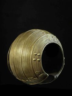 Africa |  Brass Ankle bracelet ~ Kpere ou Nga Ngbli ~ from the Baoule  people of the Ivory Coast | ca. 1930s