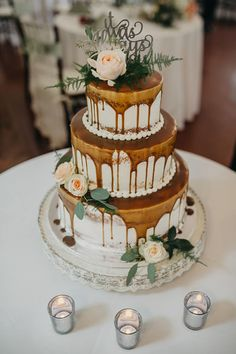 Aluscious Caramel drip semi naked wedding cake with fresh flowers by Lorelie @weddingcakesforyou.com