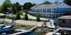 Harbourside Motel, located on Little Tub Harbour in beautiful Tobermory ON Blue Heron, Motel, Ontario, Tub, Road Trip, Cottages, Vacation, Mansions, House Styles