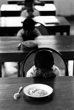 Slice of life - Robert Lebeck. Mid-day prayer in an orphanage, Indonesia, 1971 Monochrome Photography, City Photography, Black And White Photography, Surabaya, Sally Mann Photos, Ansel Adams Photos, Arnold Photos, Fotojournalismus, Jeanloup Sieff