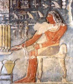 Mehu sits before an offering table laden with half-loaves of bread in his offering cahmber, THE TOMB OF MEHU AT SAQQARA