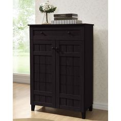 @Overstock.com - Baxton Studio Glidden Dark Brown Wood Tall Modern Shoe Cabinet  - Our Glidden shoe cabinet is made of MDF and engineered wood with dark brown faux wood grain paper veneer, five fixed-height horizontal shelves behind the cabinet doors are ideal for adult and children's shoes alike.  http://www.overstock.com/Home-Garden/Baxton-Studio-Glidden-Dark-Brown-Wood-Tall-Modern-Shoe-Cabinet/8009730/product.html?CID=214117 $184.99