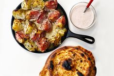 Snatch up summer's last big, juicy heirloom tomatoes and join me for a grilled naan and tomato party! Grated raw tomato and ghee-sizzled nigella seeds create a base for pretty-in-pink raita and do double duty smeared on the naan during grilling. Meanwhile, big tomato wedges get tossed in spiced yogurt before charring on the grill. The dough for the naan is sticky and soft, but don't be tempted to add flour. A supple and moist dough is key to a tender, bubbly bread. Just keep kneading and the… Fresh Lime, The Fresh, Large Cast Iron Skillet, Greek Style Yogurt, Nigella Seeds, Coriander Seeds, Heirloom Tomatoes, Dry Yeast, Naan