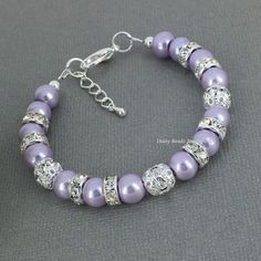 Lilac Pearl Bracelet, Lilac Bracelet, Bridesmaid Gift, Light Purple Bracelet, Bridesmaids Bracelet, Lilac Wedding, Wedding by DaisyBeadzJoaillerie on Etsy https://www.etsy.com/ca/listing/293149313/lilac-pearl-bracelet-lilac-bracelet