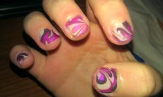 my first attempt at water marble nails....not half bad