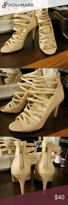 """Banana Republic Nude Strappy Heels Nude Leather strappy peep toe heels with back gold zipper and 3.5"""" heel  Worn a few times and in great used condition - tiny nick in the heel tip (a shoe cobbler could easily replace them for a few bucks) pictured above.  These are super comfortable and will match any dress, fancy or casual with other neutral accessories or a pair of skinny jeans with a flirty top. Banana Republic Shoes Heels"""