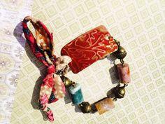 Under the Old Oak bracelet. Raised oak leaves on red by GemJelly