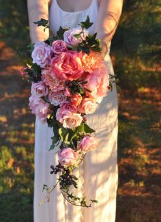 Summer cascade bouquet made with melon, coral and pink flowers with summer berries by Holly's Wedding Flowers.  Find us on Etsy at Holly's Flower Shoppe.