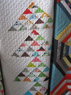 From Denyse Schmidt's sample sale!  I love the quilting AND the HST flying geese!  I want to copy it!