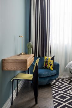 Kids room with fold out desk. Teal walls, yellow accents. http://studiomillsdesign.com