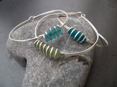 Sea glass jewelry, Rare olive green sea glass and sterling silver bangle bracelet. $31.00, via Etsy.