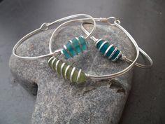 Sea glass jewelry,  Rare olive green sea glass and sterling silver bangle bracelet. $31.00, via Etsy.