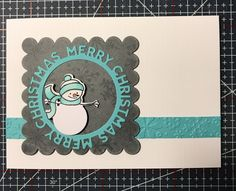 Crisp winter card. Snowman stamp. White pan pastel layer on grey paper, stamped with versamark to remove pastel.