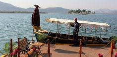 Boarding a launch on Lake Pichola in Udaipur, a supremely romantic spot.