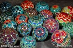 Amazing hand blown boro glass marbles by Mike Gong.