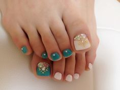 Cute toenail polish. Alternating turquoise and white... withough the big-toe jewels it would be really easy to do!