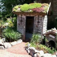 Love the moss on the roof and the use of rocks. Blumen Gardens, Sycamore, Illinois.  Make a miniture one for fairy garden, good inspiration idea.