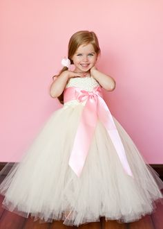 This little girl is absolutely adorable! I love this tutu dress!!   Flower Girl Tutu Dress in Classic Ivory with Custom Sash. $115.00, via Etsy.