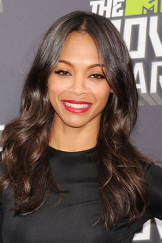 Red Carpet Beauty 2013: MTV Movie Awards, April 2013 - Zoe Saldana used red lipstick and feline eye liner flicks to offset her tumbling, centre-parted waves.