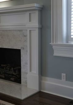Chic white fireplace (replace the ugly, large builder grade tile!)
