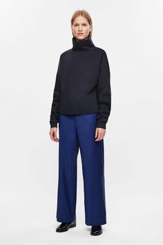 COS image 1 of Oversized high-neck sweatshirt in Dark Navy