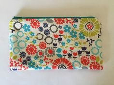 Flower Power - handmade by SHANE. Cosmetic bag made from 100% cotton. Fused with heavyweight interfacing.  Bag is lined with 100% cotton and has a turquoise YKK zipper. Handmade in the USA