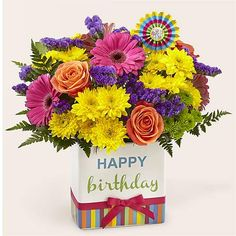 """The Birthday Brights Bouquet is a true celebration of color and life to surprise and delight your special recipient on their big day!  Hot pink gerbera daisies and orange roses take center stage surrounded by purple statice, yellow cushion poms, green button poms, and lush greens to create party perfect birthday display. Presented in a modern rectangular ceramic vase with colorful striping at the bottom, """"Happy Birthday"""" lettering at the top, and a bright pink bow at the center, this unforgettab Happy Birthday Images, Happy Birthday Greetings, Birthday Messages, Birthday Gifts, Happy Birthday Bouquet, Birthday Flower Delivery, Birthday Display, Birthday Letters, Christmas Gifts For Girlfriend"""