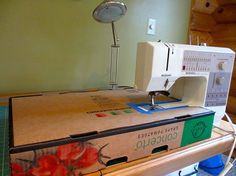 Cardboard box + some tape = flat-bed sewing surface! Patricia Belyea is a genius. -Kathy-