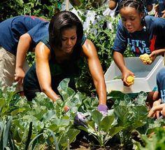 Michelle Obama planting in community garden with city children