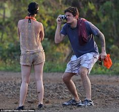 Make-up free Katy Perry joins John Mayer for ATV tour through muddy back roads of Hawaii | Mail Online