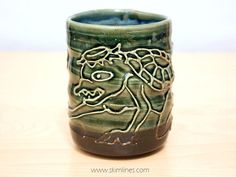 This is one of my handmade cups, featuring a mythological japanese creature, kappa. https://www.etsy.com/listing/223347171/kawatarou-river-demon-slip-trail-motif