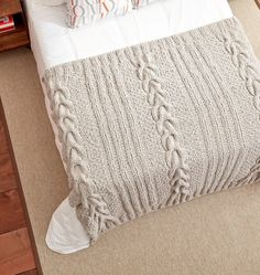 Free Knitting Pattern for Horseshoe Cable Blanket - Cable panels alternate with moss stitch and ribbing. Quick knit in super bulky yarn.