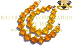 Yellow Chalcedony Faceted Flower (Quality A) Shape: Flower Faceted Length: 18 cm Weight Approx: 16 to 18 Grms. Size Approx: 13 to 14 mm Price $30.60 Each Strand