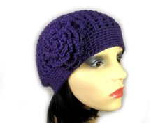 This elegant purple beanie hat is accented with a beautiful matching flower. It is hand crocheted with soft wool blend. It can be worn either casually or as an accompaniment to a more elegant outfit. Either way, it is lovely and soft, very comfortable to wear, and will keep your head cosy and warm. Elegant Outfit, Hand Crochet, Beanie Hats, Cosy, Wool Blend, Knitted Hats, Warm, Flower, Knitting