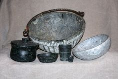 Handcarved soapstone bowls based on finds from Haithabu (back); turned pots based on late antiquity finds in Switzerland (front)