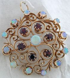 Vintage 14K Yellow Gold Pin with 13 opals & 6 Garnets