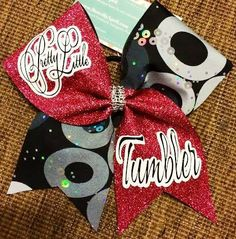 Bows by April - Pretty Little Tumbler Pink Glitter and Black, White and Silver Mystique Cheer Bow, $18.00 (http://www.bowsbyapril.com/pretty-little-tumbler-pink-glitter-and-black-white-and-silver-mystique-cheer-bow/)