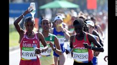 Eunice Jepkirui Kirwa of Bahrain tries to stay cool by pouring water on her head…