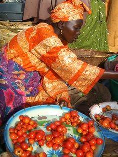 Tomato Seller at local food market in Gambia